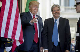 President Donald Trump greets Italian Prime Minister Paolo Gentiloni as he arrives at the West Wing of the White House in Washington, April 20, 2017.