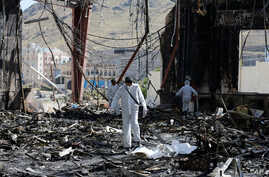 Forensic experts investigate the scene at the community hall where Saudi-led warplanes struck a funeral in Sanaa, the capital of Yemen, Oct. 9, 2016.