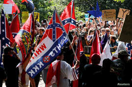 Members of the Ku Klux Klan face counter-protesters as they rally in support of Confederate monuments in Charlottesville, Virginia,  July 8, 2017.