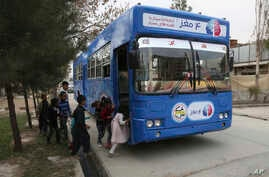 Afghan children board a library on wheels, in Kabul, Afghanistan, March 10, 2018.