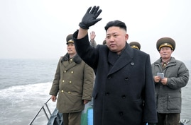 North Korean leader Kim Jong Un with his military advisors, March 7, 2013.