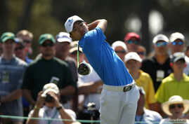 Asia-Pacific Amateur Championship winner, 14 year old Guan Tianlang of China hits his tee shot on the first hole during a practice round in preparation for the 2013 Masters golf tournament at the Augusta National Golf Club in Augusta, Georgia, Apr. 9