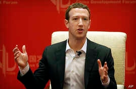 FILE - Facebook CEO Mark Zuckerberg speaks during a panel discussion in Beijing, March 19, 2016. The world's biggest social network is starting to face the consequences of not preventing the often unforeseen problems that keep cropping up on its pl...