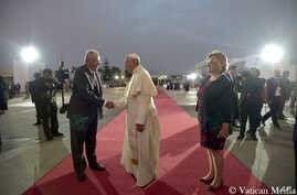 Pope Francis shakes hands with Peru's President Pedro Pablo Kuczynsk, left, as First Lady Nancy Lange looks on during a farewell ceremony ahead of his return flight to Rome, at Lima's airport, Peru, Jan. 21, 2018.