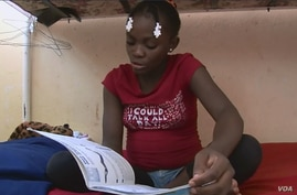 Since moving to a Haitian orphanage, Venise Louis has become a diligent student.
