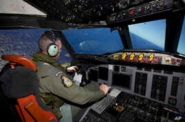 Captain Flt. Lt. Tim McAlevey of the Royal New Zealand Air Force flies a P-3 Orion in search for the missing Malaysia Airlines Flight 370 over the Indian Ocean, April 11, 2014.
