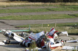 FILE - The wreckage of the Polish Tupolev Tu-154M presidential aircraft that killed Polish president Lech Kaczynski and 95 others is seen at the airport in Smolensk, Oct. 1, 2010.