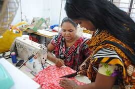 Women work in a tiny garment workshop opened and staffed by survivors of the collapse of Rana Plaza in Dhaka. (Amy Yee for VOA News)