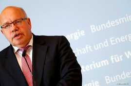 FILE - German Economic Affairs and Energy Federal Minister Peter Altmaier addresses the media in Berlin, July 17, 2018.