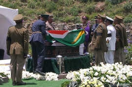 In this video frame grab, military officers remove a South African flag from Nelson Mandela's casket at his burial site in Qunu, South Africa, Sunday, Dec. 15, 2013.