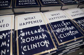 """FILE - A box of Hillary Clinton's book """"What Happened"""" are staged to be distributed outside the Warner Theatre in Washington, Sept. 18, 2017."""