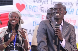 Duop Pur Doup whose songs were widely played during the South Sudan referendum campaign performs at the fundraiser for Abyei in Juba in October 2013. He and other artists will be going to Abyei later this week.
