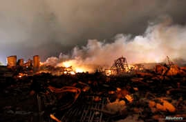 The remains of a fertilizer plant burn after an explosion at the plant in the town of West, near Waco, Texas, early April 18, 2013.
