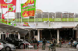 Military personnel inspect the site of a bomb attack at a supermarket in Pattani, Thailand, May 10, 2017.
