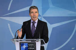 NATO Secretary General Anders Fogh Rasmussen speaks during a media conference at NATO headquarters in Brussels, Aug. 29, 2014.