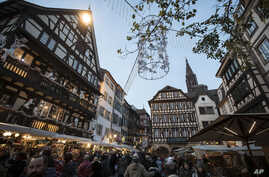 People are once again in the streets as Strasbourg's Christmas market reopens under the protection of police, in Strasbourg, France, Dec. 15, 2018.