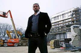Architect Jonathan Garland is pictured at the construction site of a building he helped design in the Mattapan neighborhood of Boston, March 27, 2018. When Garland attended Boston Architectural College, but he didn't see many who looked like him. The