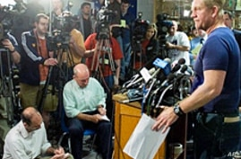 Kevin Stricklin (R), an administrator with Mine Safety and Health Administration, speaks during a press conference near Upper Big Branch coal mine in Montcoal, West Virginia, 08 Apr 2010, three days after an explosion killed 25 miners