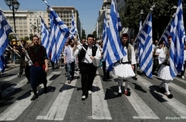 Greek municipal workers dressed in traditional garb protest government plan to layoff thousands of public sector workers, Athens, April 26, 2013.