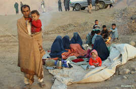 An Afghan family waits for help from the government and aid organizations in Takhar, Afghanistan Oct. 11, 2016, after fleeing their homes in neighboring Kunduz, which has been the scene of fighting between Taliban militants and government troops.
