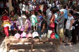 Cambodian residents line up to vote in local elections at a polling station in Chak Angre Leu on the outskirts of Phnom Penh, Cambodia, Sunday, June 4, 2017. Cambodians voted in local elections Sunday that could shake longtime ruler Prime Minister Hu