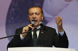 Turkey's Prime Minister Tayyip Erdogan addresses his supporters in Istanbul, May 12, 2013.
