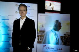 "Director Beda Docampo Feijoo  poses for a picture during the Avant premiere of ""Francisco. El Padre Jorge,"" in Buenos Aires, Argentina, Sept. 8, 2015. The film about Pope Francis' life will open in cinemas Sept. 10, 2015."