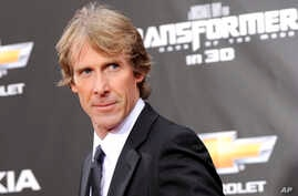 """FILE -  executive producer and director Michael Bay attends the """"Transformers: Dark Of The Moon"""" premiere in Times Square in New York."""