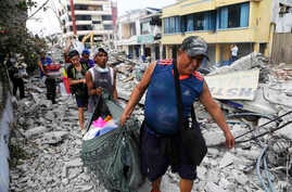 Residents recover their belongings days after an earthquake in Pedernales, Ecuador, April 20, 2016.
