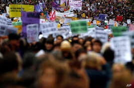 Thousands of people take part in a protest against sexism and gender violence, in Madrid, Spain, Nov. 25, 2018.