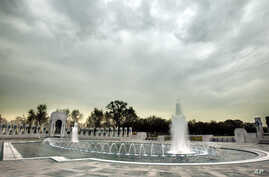 With all of the fountains turned on, workers put the final touches on the World War II Memorial, which is in the final stages of clean up, Thursday, April 8, 2004, in Washington, in anticipation of opening next week. The memorial will be officially d