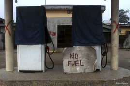FILE - A closed fuel station is seen in the Ahoada community near Nigeria's oil hub city of Port Harcourt.
