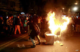 Protestors burn furniture taken out of the demolished President's office in downtown Skopje, Macedonia, April 13, 2016. Opposition supporters gathered in the capital Skopje for a second day to demand the resignation of President Gjorge Ivanov after h