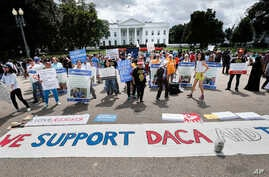 Supporters of Deferred Action for Childhood Arrivals program (DACA), demonstrate on Pennsylvania Avenue in front of the White House in Washington, Sept. 3, 2017.