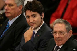 Canada's Prime Minister Justin Trudeau, center, sits with Cuba's President Raul Castro and First Vice President Miguel Diaz-Canel Bermudez, left, at Havana University in Havana, Cuba, Nov. 16, 2016.