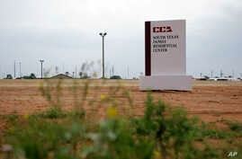 This June 30, 2015, file photo shows a sign at the entrance to the South Texas Family Residential Center in Dilley, Texas. A judge has ordered Dec. 24, 2018, the U.S. government not to deport a Honduran woman without her 15-year-old daughter.