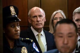 FILE - Director of National Intelligence Dan Coats arrives as House and Senate lawmakers from both parties gather for a classified briefing in a secure room .