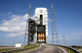 With access doors at Space Launch Complex 37 opened, the Orion and Delta IV Heavy stack is visible in its entirety inside the Mobile Service Tower where the vehicle is undergoing launch preparations, Nov. 24, 2014. (NASA/Kim Shiflett)