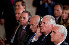 Vice President Mike Pence, right, Secretary of State Rex Tillerson, 2nd right, attend a news conference between President Donald Trump and Colombian President Juan Manuel Santos in the East Room of the White House, May 18, 2017, in Washington.