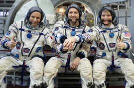 From left: CSA astronaut David Saint Jacques, Russian cosmonaut Оleg Kononenko and U.S. astronaut Anne McClain pose in a mock-up of a Soyuz space craft at Russian Space Training Center in Star City, Russia, Nov. 14, 2018.