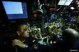 Polish marines of submarine ORP SEP watch instruments as the submarine dives during NATO Submarine Rescue Exercise Dynamic Monarch on Gdansk Bay,  near Hel in the Baltic Sea, May 22, 2014.