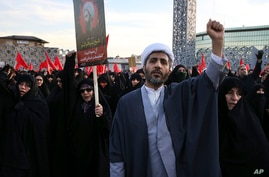 A Muslim cleric chants slogans alongside women in a rally to protest the execution by Saudi Arabia last week of Sheikh Nimr al-Nimr, a prominent opposition Saudi Shiite cleric, in Tehran, Iran, Jan. 4, 2016.