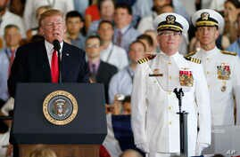 President Donald Trump, left, puts the USS Gerald Ford into commission as Navy commanders listen, at Naval Station Norfolk in Norfolk, Virginia, July 22, 2017.