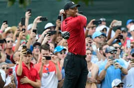 Tiger Woods hits from the third tee during the final round of the Tour Championship golf tournament Sunday, Sept. 23, 2018, in Atlanta.