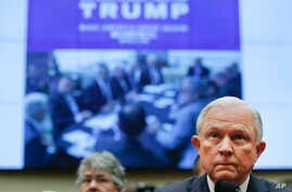 """An image reading """"National Security Meeting TRUMP Make America Great Again Washington, D.C, March 31 2016"""" is displayed behind Attorney General Jeff Sessions as he testifies during a House Judiciary Committee hearing on Capitol Hill, Tuesday, Nov. 14"""