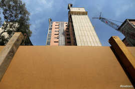 A building being demolished is seen five months after a Sept. 19, 2017, earthquake, in the Colonia Doctores neighborhood in Mexico City, Mexico, Feb. 7, 2018.