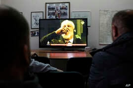 Bosnian people watch the live TV broadcast from the International Criminal Court for the former Yugoslavia (ICTY) in The Hague as Slobodan Praljak brings a bottle to his lips, in southern Bosnian town of Mostar 140 kms south of Sarajevo, on Wednesday...