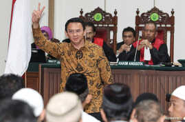 "Jakarta's Governor Basuki ""Ahok"" Tjahaja Purnama gestures inside the courtroom during his blasphemy trial in Jakarta, Indonesia, Jan. 3, 2017."