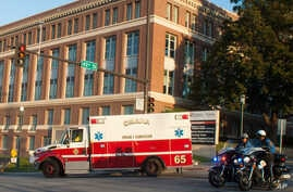 An ambulance transports Ashoka Mukpo, who contracted Ebola while working in Liberia, to the Nebraska Medical Center's specialized isolation unit in Omaha, Nebraska, Oct. 6, 2014.