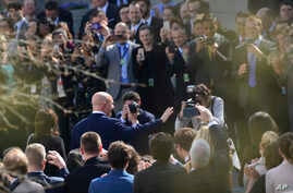 Staff members applaud as outgoing national security adviser H.R. McMaster walks out of the West Wing of the White House in Washington, April 6, 2018, on his last day.
